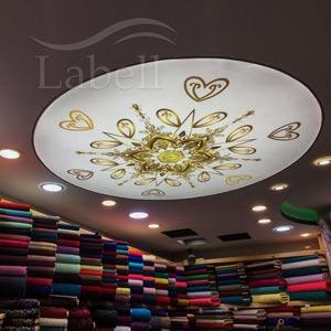 طراحی داخلی پارچه فروشی با سقف کشسان